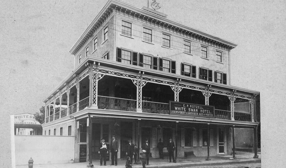 The White Swan Hotel, Mt. Airy. Six men and three children standing along Germantown and Mt. Airy avenues. (Courtesy of Germantown Historical Society, Philadelphia, PA)