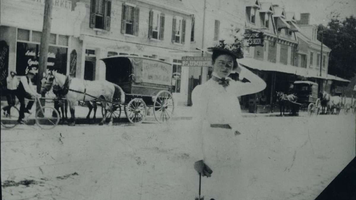 Print of an unknown lady. The background is the block of East Evergreen Avenue and Germantown Avenue. (Courtesy of Chestnut Hill Historical Society)