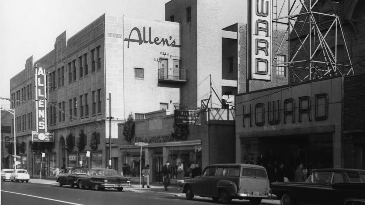 Black and white photograph of general view of Allen's Department Store, taken from the north side of Chelten Avenue facing east-northeast towards Germantown Avenue and Armat Street. Note period cars along Chelten Avenue, with trolley tracks removed. n.d. , circa 1960. (Courtesy of Germantown Historical Society, Philadelphia, PA)