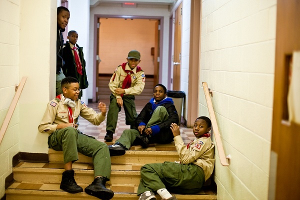 <p><p>Members of Boy Scout Troop 358 sit in a hallway of Grace Baptist Church in Germantown before the start of their meeting. (Brad Larrison/for NewsWorks)</p></p>