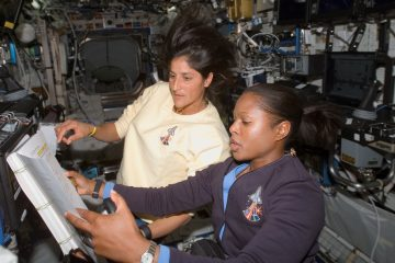 Astronauts Joan E. Higginbotham and Sunita L. Williams refer to a procedures checklist as they work together in the Destiny laboratory of the International Space Station. (<a href=
