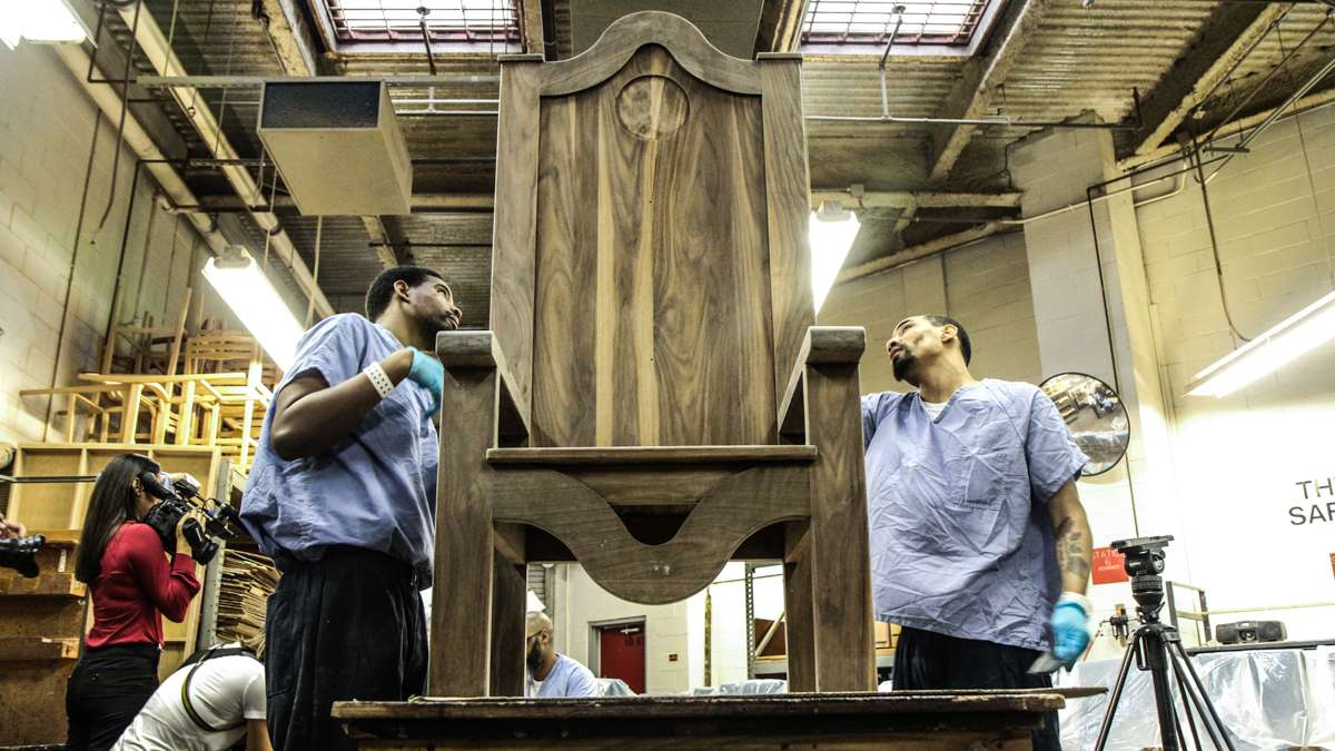 Inmates at Philadelphia Industrial Correctional Center sand a chair the Philadelphia prison will give to Pope Francis during his visit. (Kimberly Paynter/WHYY)