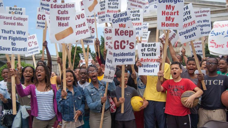 Students, alumni and parents gathered at Girard College in Philadelphia on June 14 to protest the plan to eliminate grades nine through 12 at the end of next year. (Ann  Marie Awad/for NawsWorks)