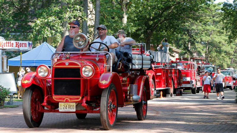 At the end of the muster, the fire engines parade past spectators as the exit the WheatonArts grounds. (Jana Shea for NewsWorks)