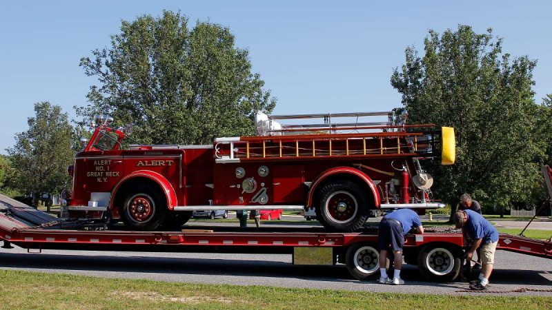 Some of the historic fire engines are transported to the muster via flatbed trailer. (Jana Shea for NewsWorks)