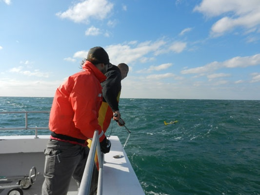 """<p><p class=""""p1"""">In this series of images, Rutgers oceanography Ph.D. student Travis Miles (orange jacket) leads the retrieval of an underwater glider off the coast of Belmar, N.J. The glider had been transmitting data during Hurricane Sandy on the ocean's role in the superstorm. (Imagescourtesy Kaycee Coleman/Rutgers)</p></p>"""