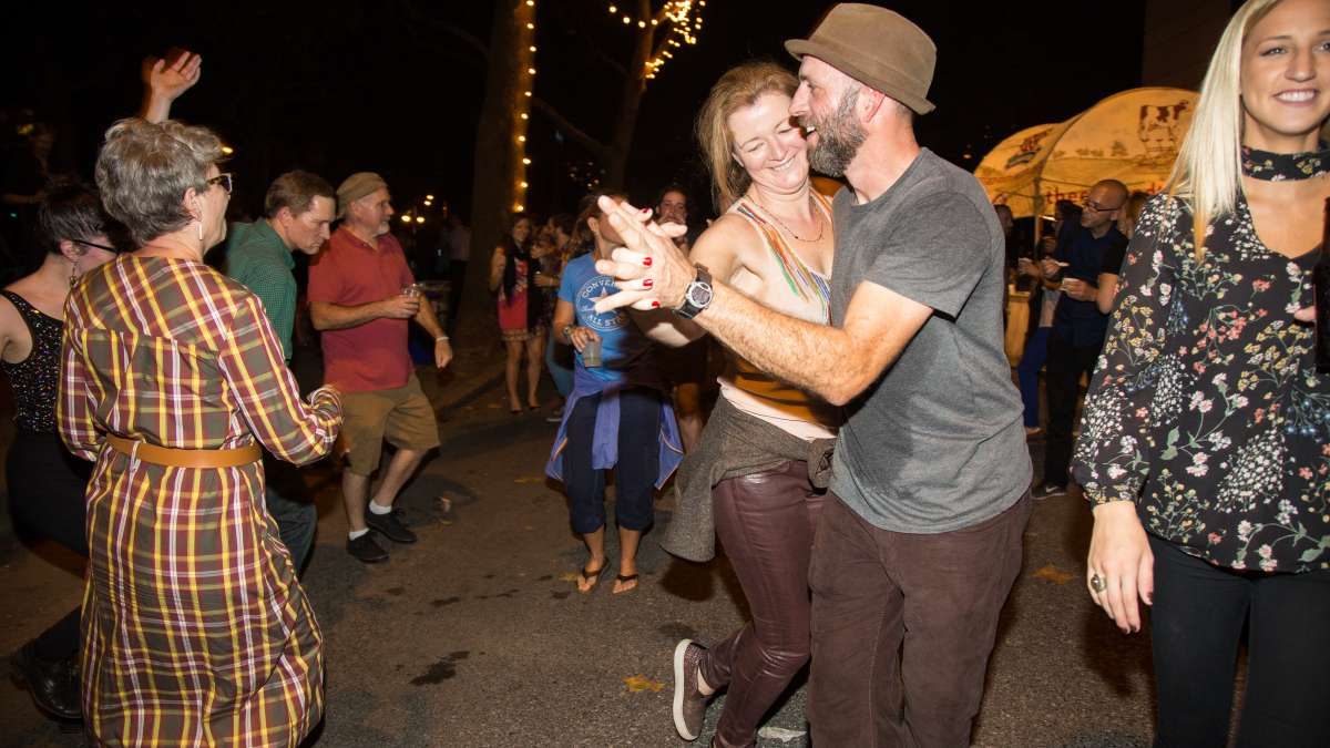 People dance to the music of the West Philadelphia Orchestra at Fairmount Park Conservancy's 5th annual Glow in the Park gathering.
