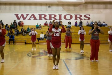 East High cheerleaders perform at halftime during a high school basketball game between the East Warriors and the General McLane Lancers in Erie, Pennsylvania. (Lindsay Lazarski/WHYY)