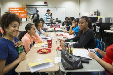 Liz Herrera-Reynoso, 14, left, and Eskarlena Conce-Molina, 14, right, both students of York Technical High School, attend an after school college prep program with kids from throughout the county in York, Pennsylvania. (Jessica Kourkounis/For Keystone Crossroads)