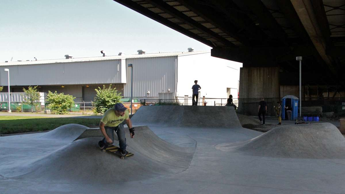 At Crescent Trail Park, skateboarders take advantage of a small park under the Grays Ferry Road. (Emma Lee/for NewsWorks)