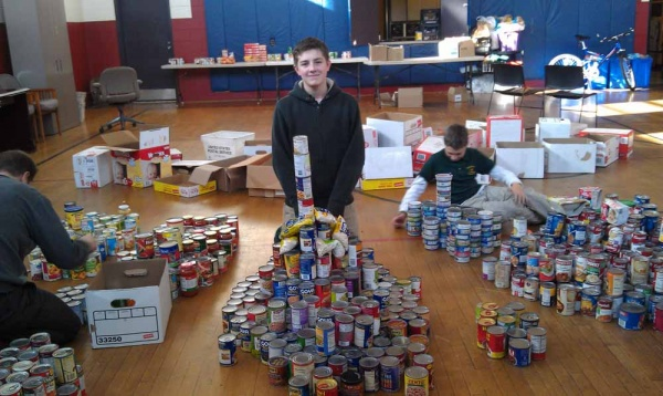 <p><p>Seventh grade student Ben Gongon poses with his tower of beans. (Yasmein James/for NewsWorks)</p></p>