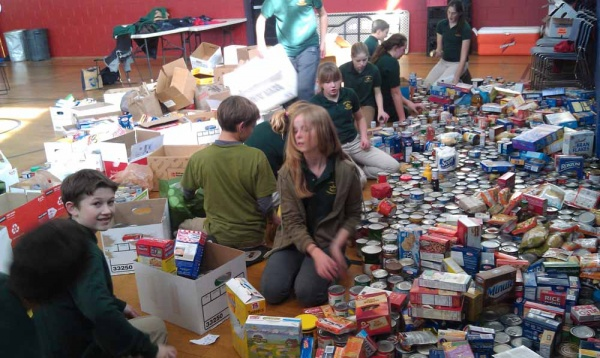 <p><p>After taking the non-perishable items out of the boxes, the students quickly began making piles for North Light Community Center's cupboard. (Yasmein James/for NewsWorks)</p></p>