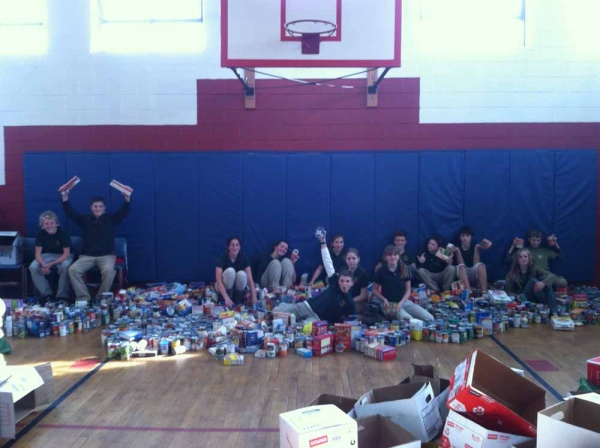 <p><p>The Student Leadership team poses with the 2,316 items collected for North Light Community Center's food cupboard. (Photo courtesy of Steve Masterson)</p></p>