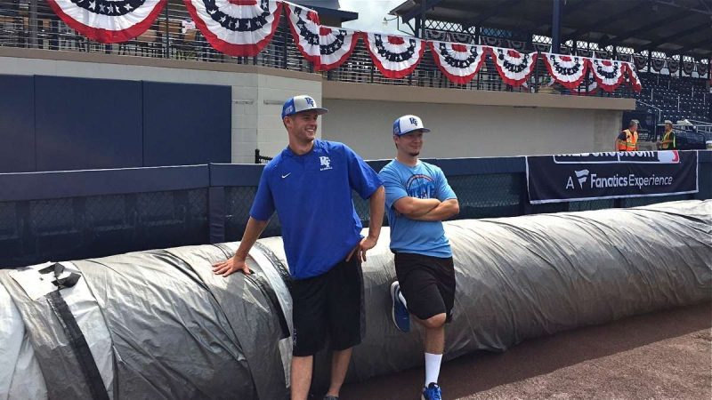 Pennsylvania College of Technology baseball players Nick Perna (left) and Cole Hofmann train at Historic Bowman Field to serve as part of the grounds crew during the inaugural MLB Little League Classic on Sunday in Williamsport, Pennsylvania. (Chris Howard)
