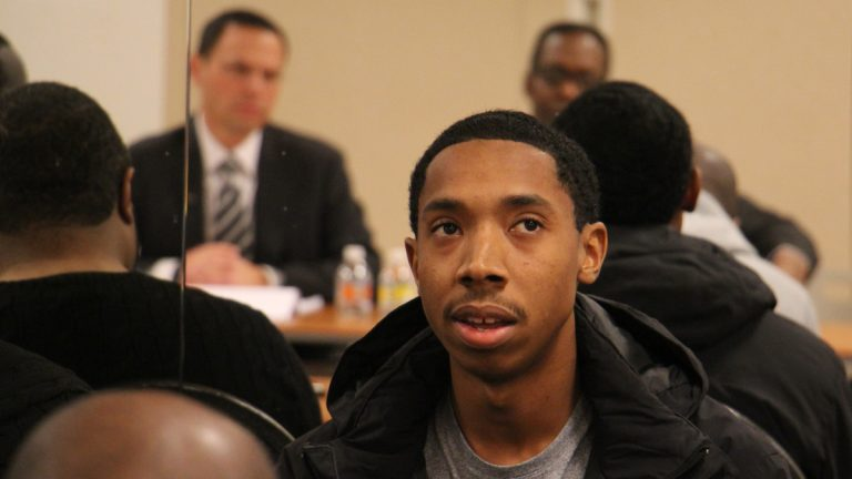 John Solomon, 24, talks about his experiences with guns, which began when he was 11 years old and ended with a 5-year prison sentence. He spoke during a community meeting in North Philadelphia with Pennsylvania Attorney General-elect Josh Shapiro. (Emma Lee/WHYY)