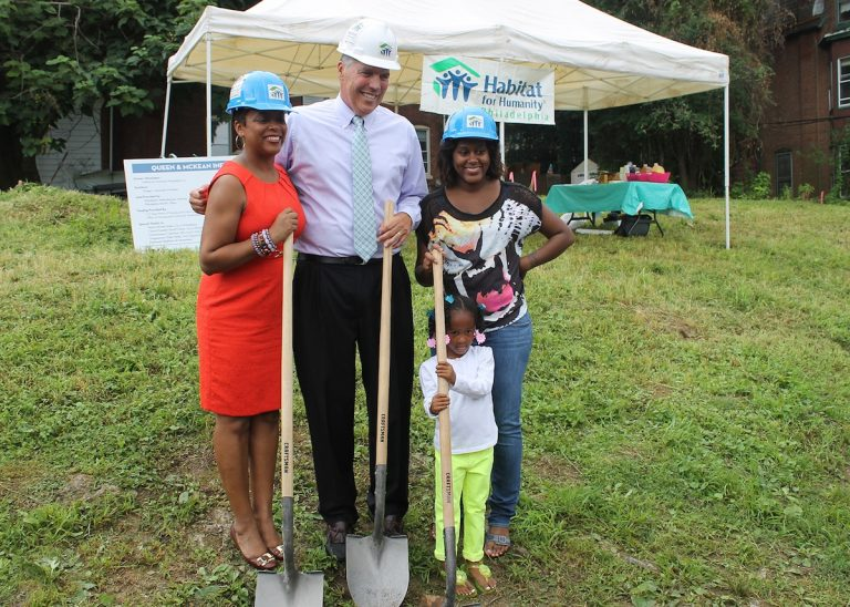 Councilwoman Cindy Bass and Frank Monaghan of Habitat for Humanity breaking ground with future homeowner Quaseemah Carr and her daughter, Jornee. (Matthew Grady/for NewsWorks)