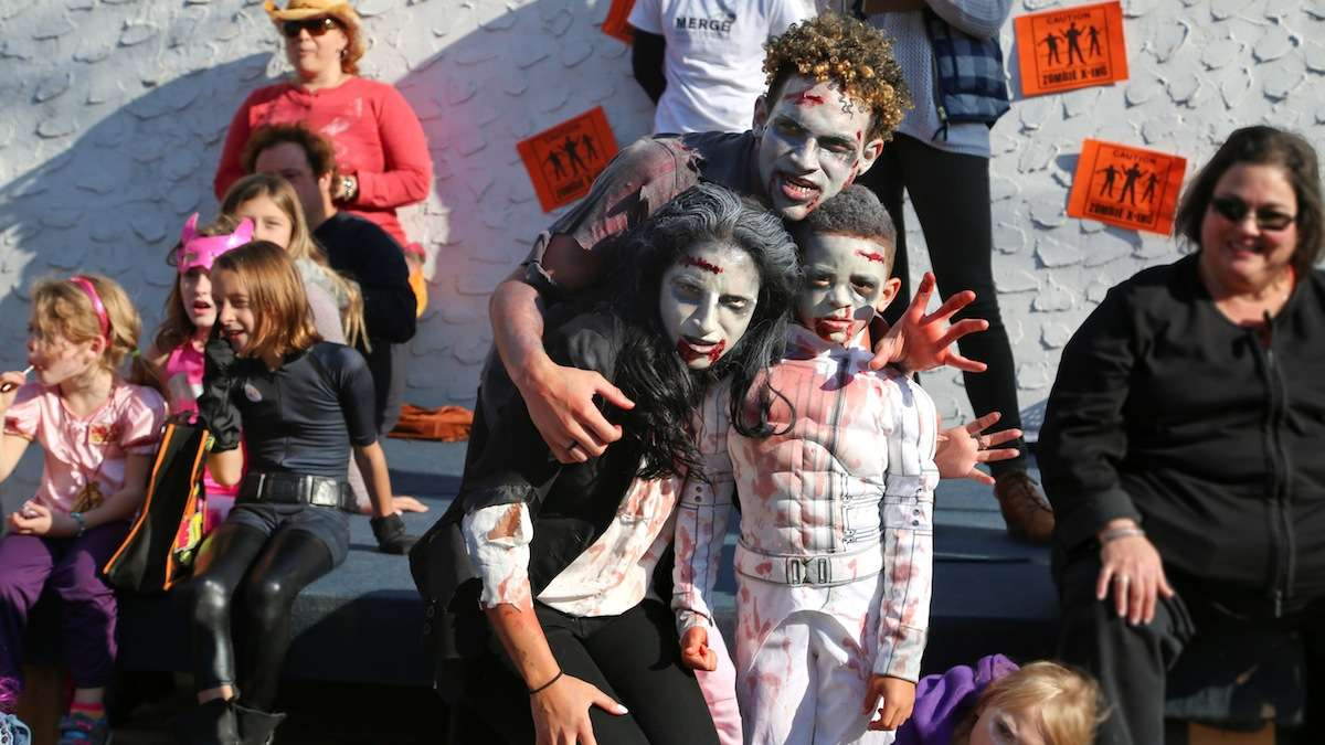 Zombie Thriller Dance Off winners Erik and Erika Coley with their little zombie Ryder. (Natavan Werbock/for NewsWorks)
