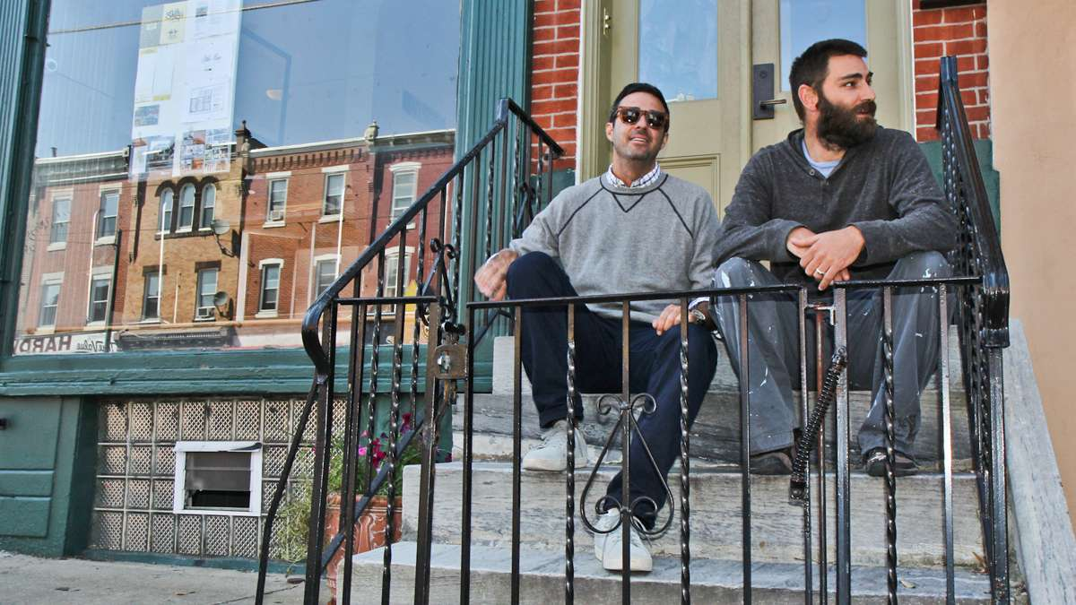 Co-manager David Waxman of MM Partners and Jeb Woody, CEO of Shifty's Taco on the development company's stoop in Brewerytown. (Kimberly Paynter/WHYY)