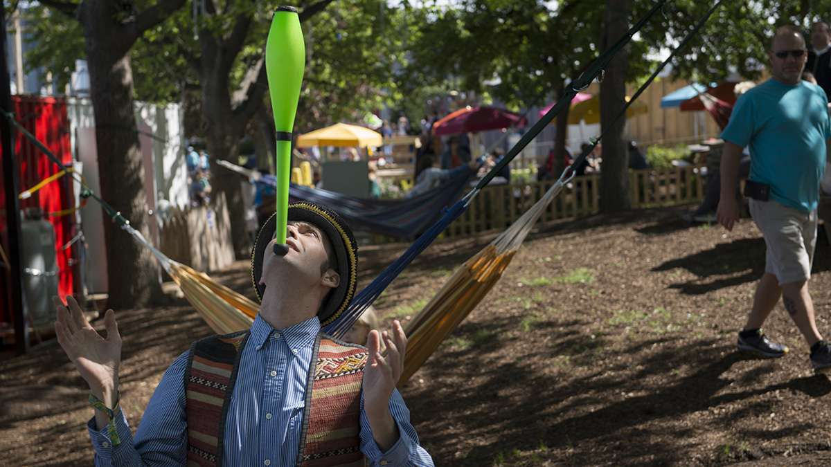 Professional juggler David Ramsay IV shows off his talents during the opening weekend of the Spruce Street Harbor Park.