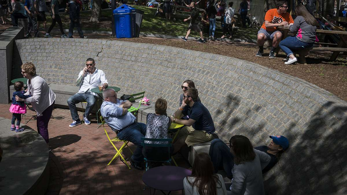 Visitors relax in the sun and shade during the opening weekend of the Spruce Street Harbor Park.