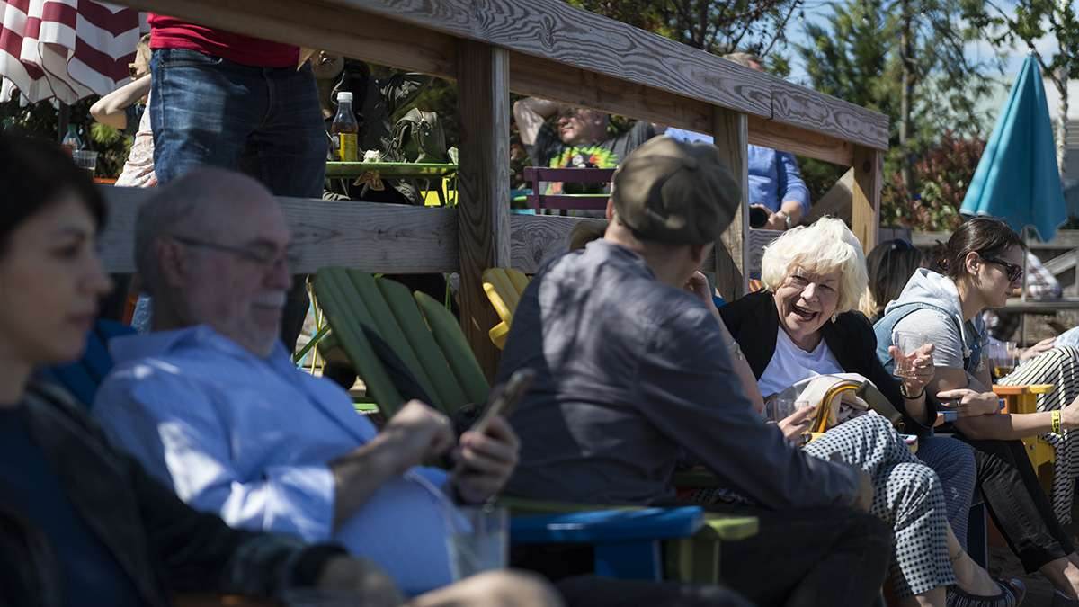 Eileen Augustine chats with friends during the opening weekend of the Spruce Street Harbor Park.