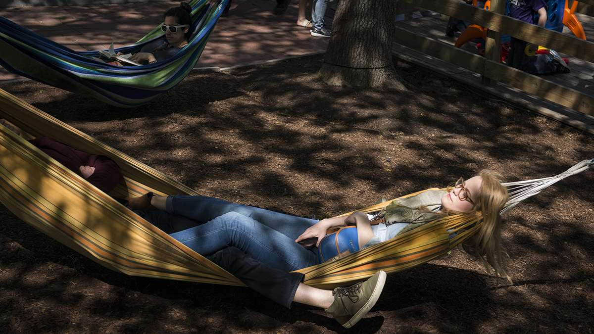 Elizabeth Riggio relaxes in one of the more than 50 hammocks at the Spruce Street Harbor Park.