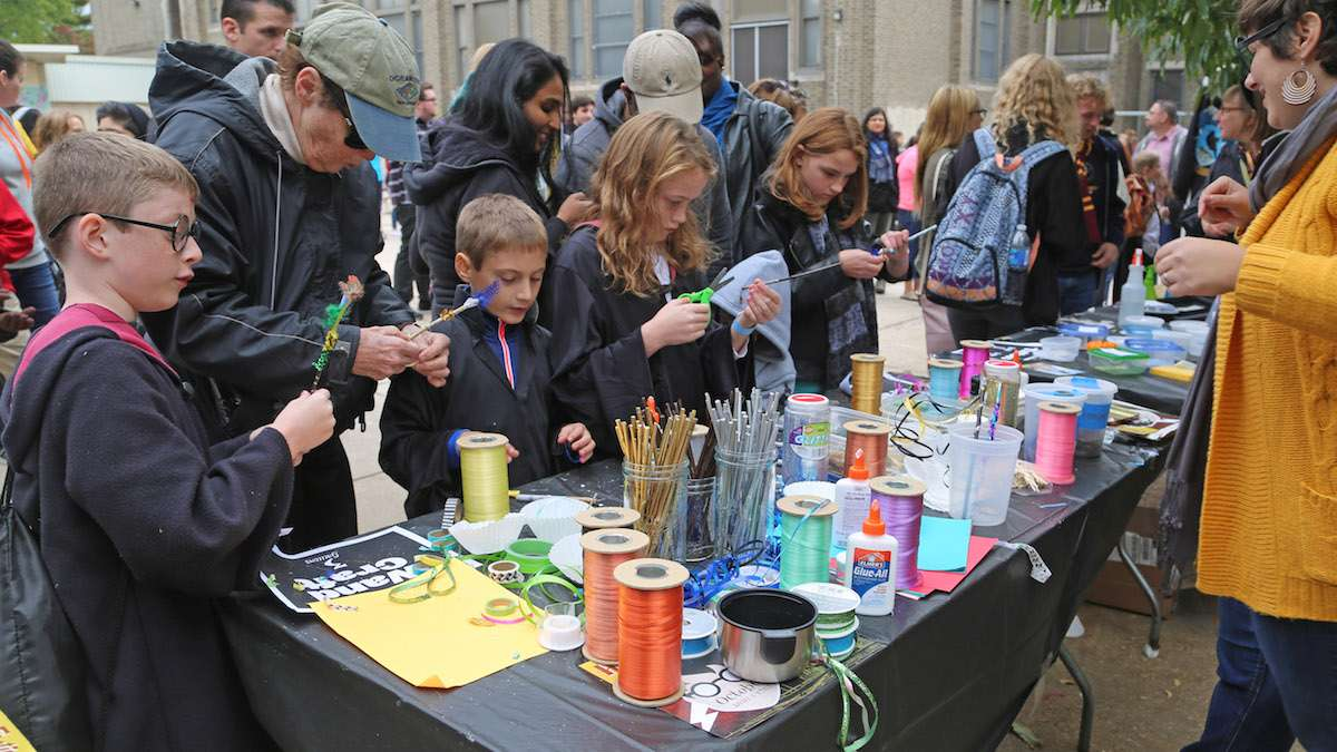 Kids gathered around wand craft station at the Jenks Academy of Witchcraft & Wizardry Kid Zone (Natavan Werbock/for NewsWorks)