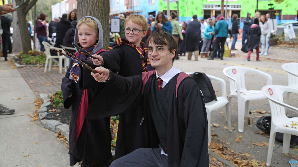 Harry Potter (Dan Lemoine) casting a spell with fans Desmond and Damien (Natavan Werbock/for NewsWorks)