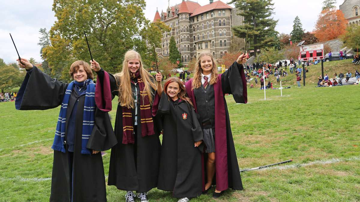 (L-R) Cameron, Anna, Amy and Ericka dressed in their Harry Potter best at the Chestnut Hill College campus (Natavan Werbock/for NewsWorks)