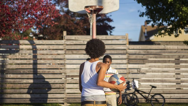Kids play basketball at a neighborhood park in Hazleton, Pennsylvania. (Jessica Kourkounis/For Keystone Crossroads)