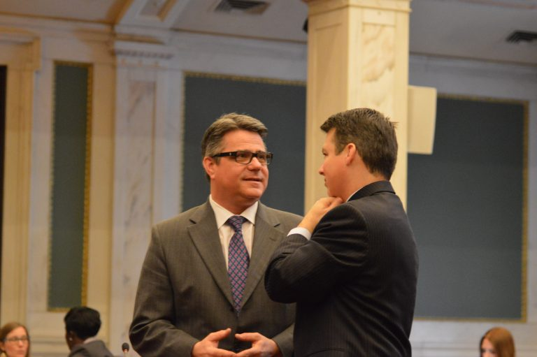 Councilman Bobby Henon speaks with U.S. Rep. Brendan Boyle prior to the hearing. (Tom MacDonald/WHYY)