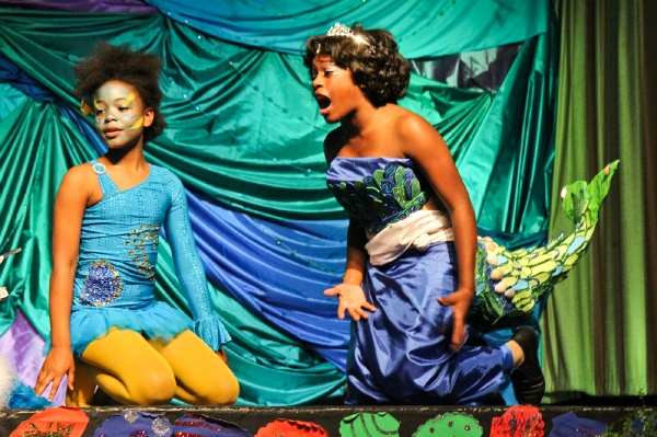<p>6th grade student Mizan Ahmad as the character Flounder and 8th grade student Jhayda Washington as Ariel in Henry Elementary's production of The Little Mermaid. (Kimberly Paynter/for NewsWorks)</p>