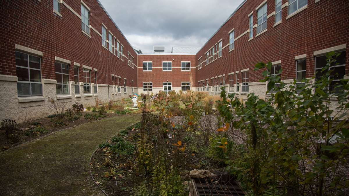 The campus at Upper Dublin High School has three seperate courtyards. This one is tended by students and has outdoor seating for an outdoor learning option. (Emily Cohen for NewsWorks)
