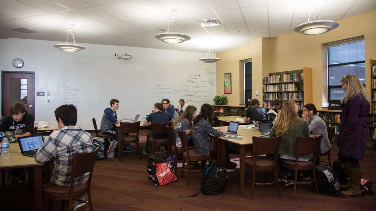 The library at Upper Dublin High School was reimagined as a media center during the rebuild of the campus. The room is broken up into three parts, books, computers space, and tables for studying. (Emily Cohen for NewsWorks)