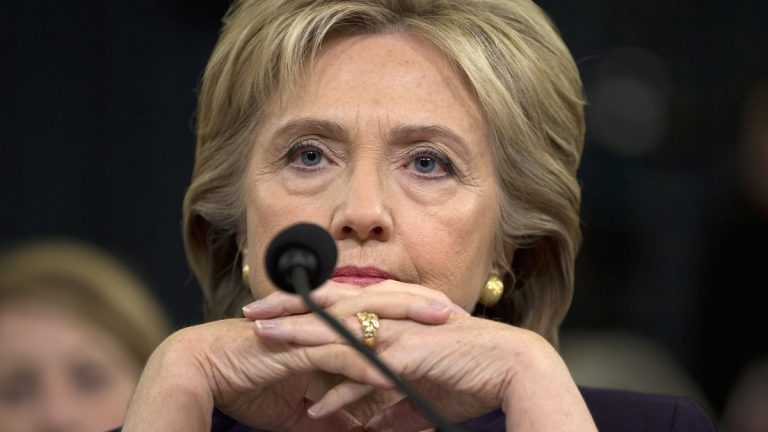 Democratic presidential candidate Hillary Rodham Clinton listens as she testifies on Capitol Hill in Washington, Thursday, Oct. 22, 2015. (AP Photo/Evan Vucci)