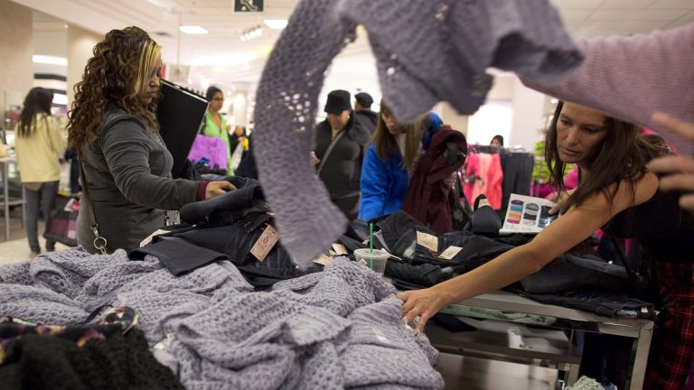 Shoppers rummage through a pile of sweaters on sale at a J.C. Penney store in Las Vegas. (AP Photo/Julie Jacobson, file)