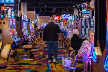Players try their luck on the slot machines at the Hollywood Casino at Penn National Race Course in Dauphin County, Pennsylvania.  State lawmakers have until the end of May to fix a section of the state's gaming law that the Pennsylvania Supreme Court ruled unconstitutional.  The part of the law that came into question involves the local share tax.  (Lindsay Lazarski/WHYY)