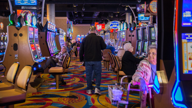 Players try their luck on the slot machines at the Hollywood Casino at Penn National Race Course in Dauphin County, Pennsylvania.  (Lindsay Lazarski/WHYY)