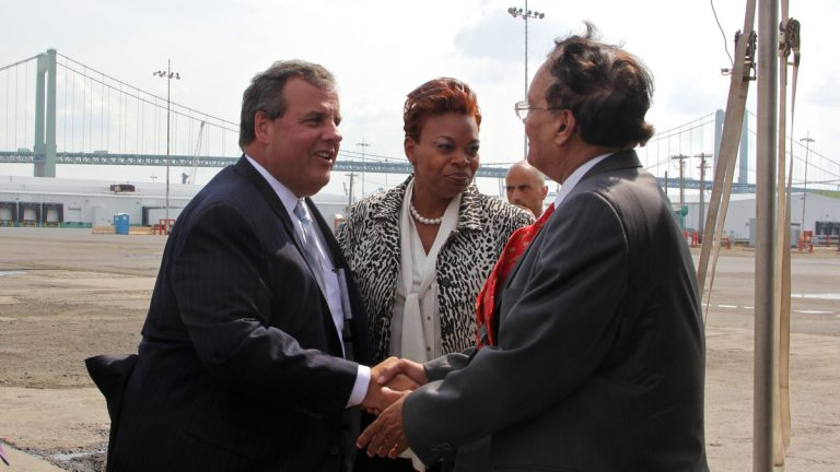 Gov. Chris Christie and Camden Mayor Dana Redd greet Krishna Singh, president of Holtech International, in July 2014. Singh said he would bring jobs to Camden in exchange for up to $260 million in tax incentives. (Emma Lee/WHYY)