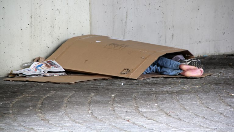 Homeless people sleep under an overpass in Philadelphia. (Emma Lee/Whyy, file)