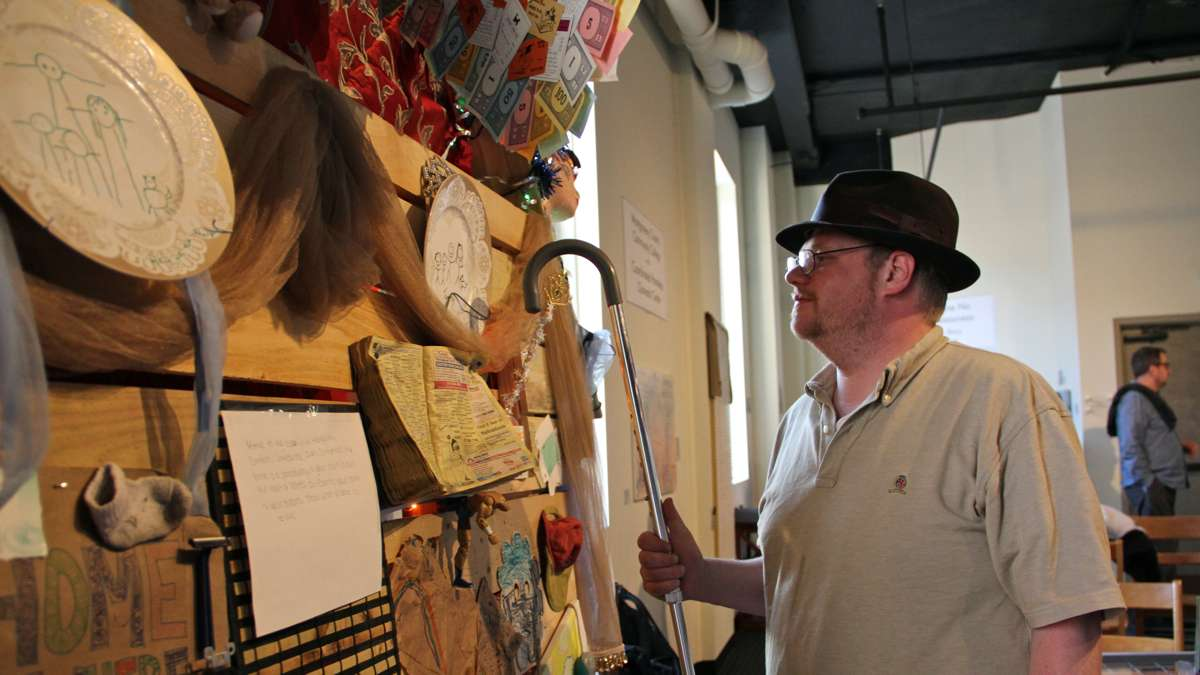 Tom Nance, a client of Coordinated Homeless Outreach Center, admires the work he helped to create. (Emma Lee/WHYY)