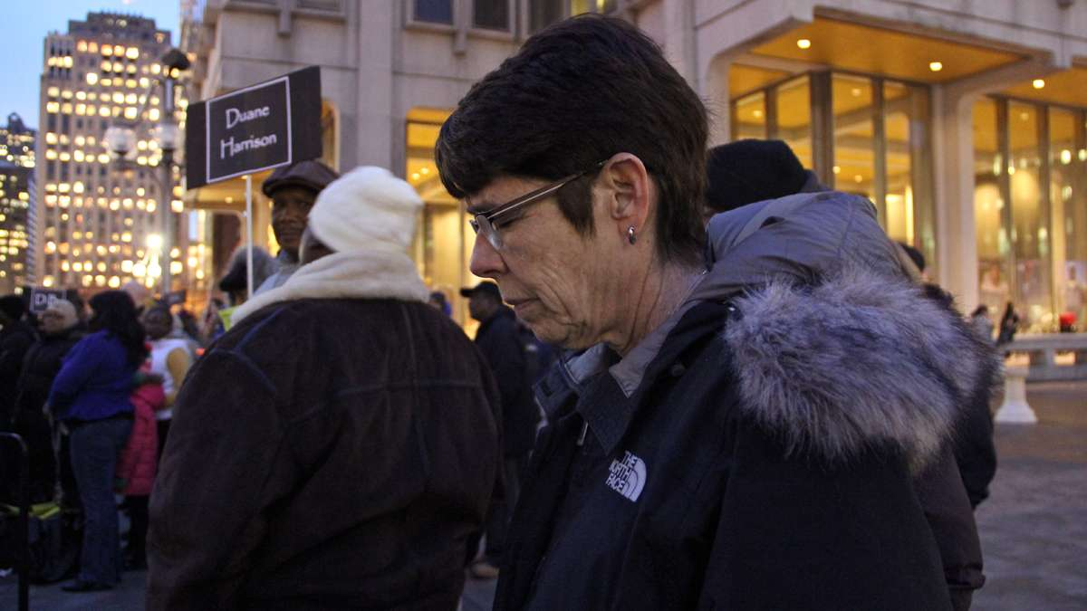 Sister Mary Scullion bows her head as 127 names are read in memory of Philadelphia's homeless who died in 2013. (Emma Lee/for NewsWorks)