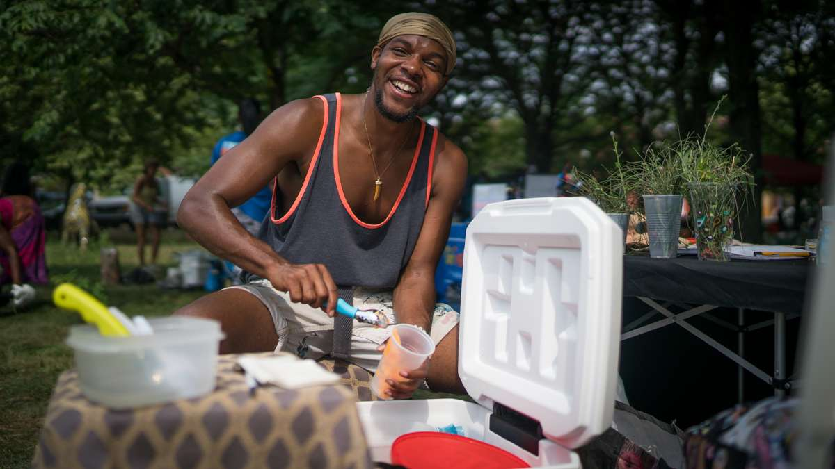 Henry Lee of Art Wear serves water-ice at the 4th annual Hoodstock Festival in North Philadelphia on July 22, 2017.