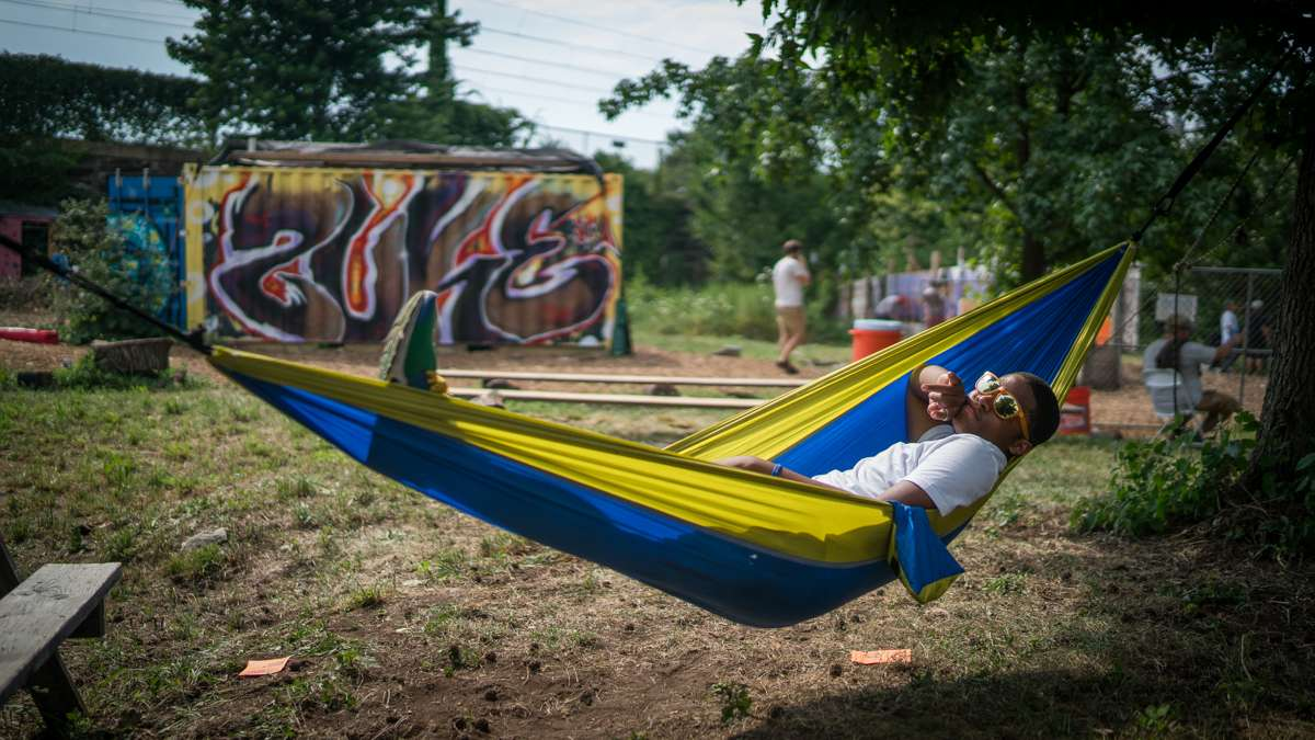 Daiquan Green relaxes in a hammock at the 4th annual Hoodstock Festival in North Philadelphia on July 22, 2017.