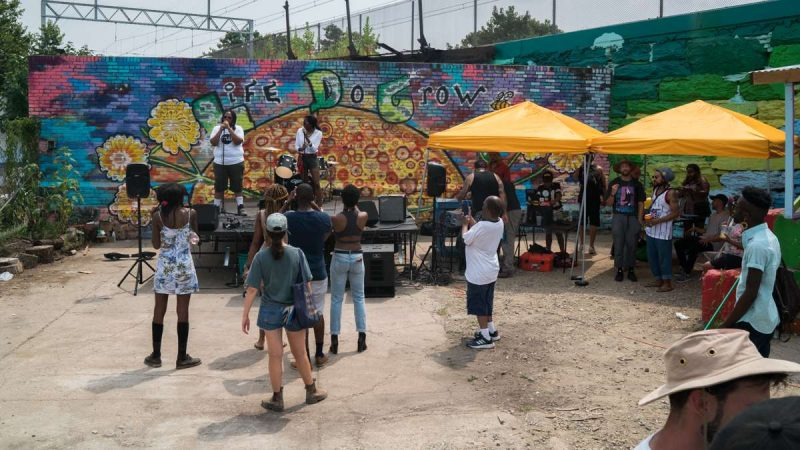 Attendees of the 4th annual Hoodstock Festival at Life Do Grow Farm in North Philly take in a musical performance on July 22, 2017.