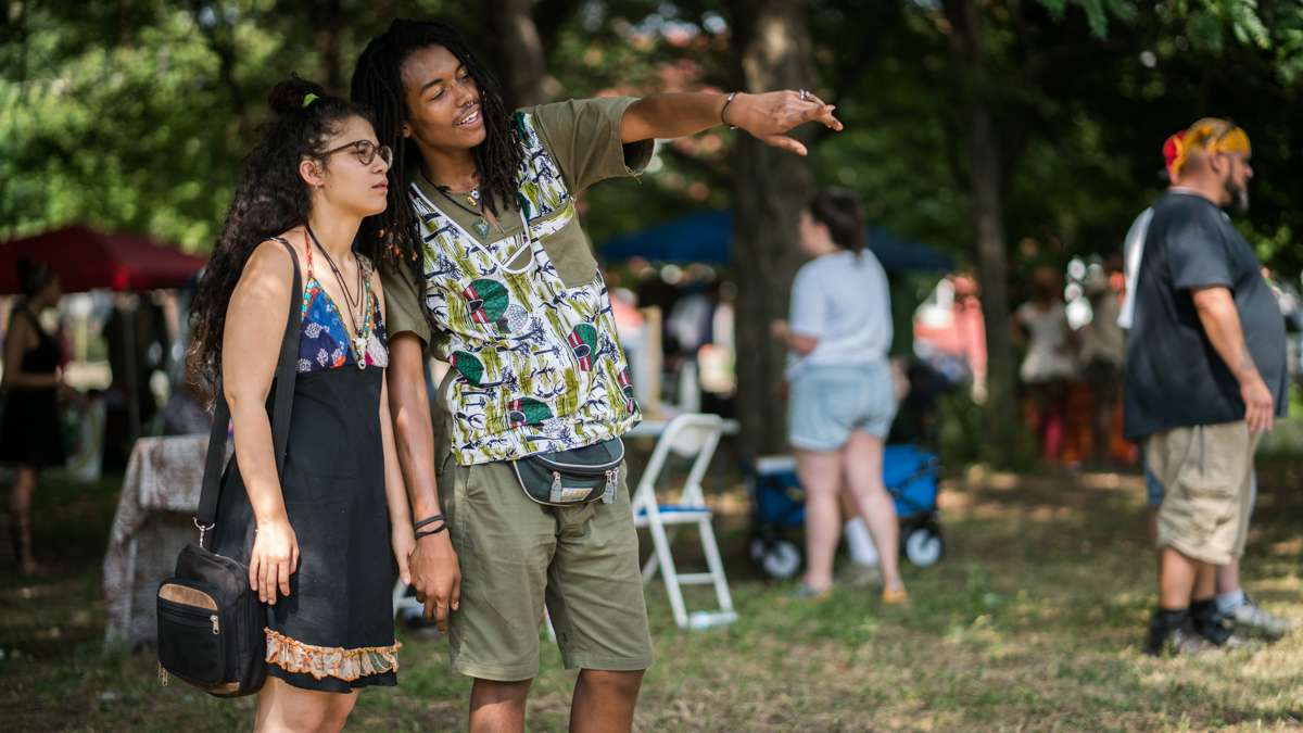 Chelsea Tripp (left) and Osse admire art on display at the 4th annual Hoodstock Festival in North Philadelphia on July 22, 2017.