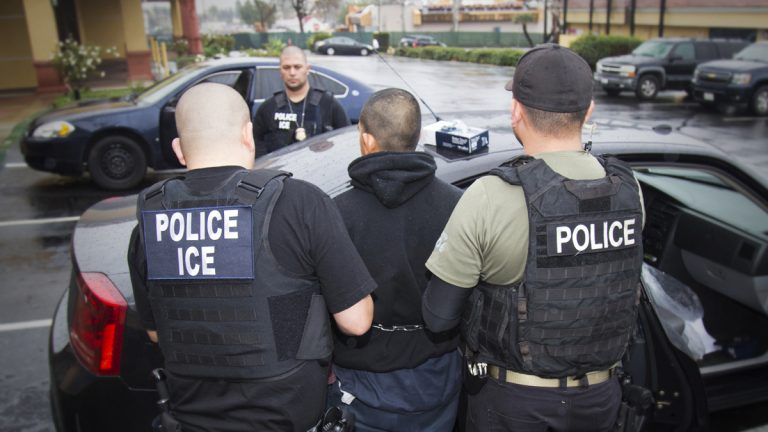 In this Tuesday, Feb. 7, 2017, photo released by U.S. Immigration and Customs Enforcement, foreign nationals are arrested during a targeted enforcement operation conducted by U.S. Immigration and Customs Enforcement (ICE) aimed at immigration fugitives, re-entrants and at-large criminal aliens in Los Angeles. (Charles Reed/U.S. Immigration and Customs Enforcement via AP)