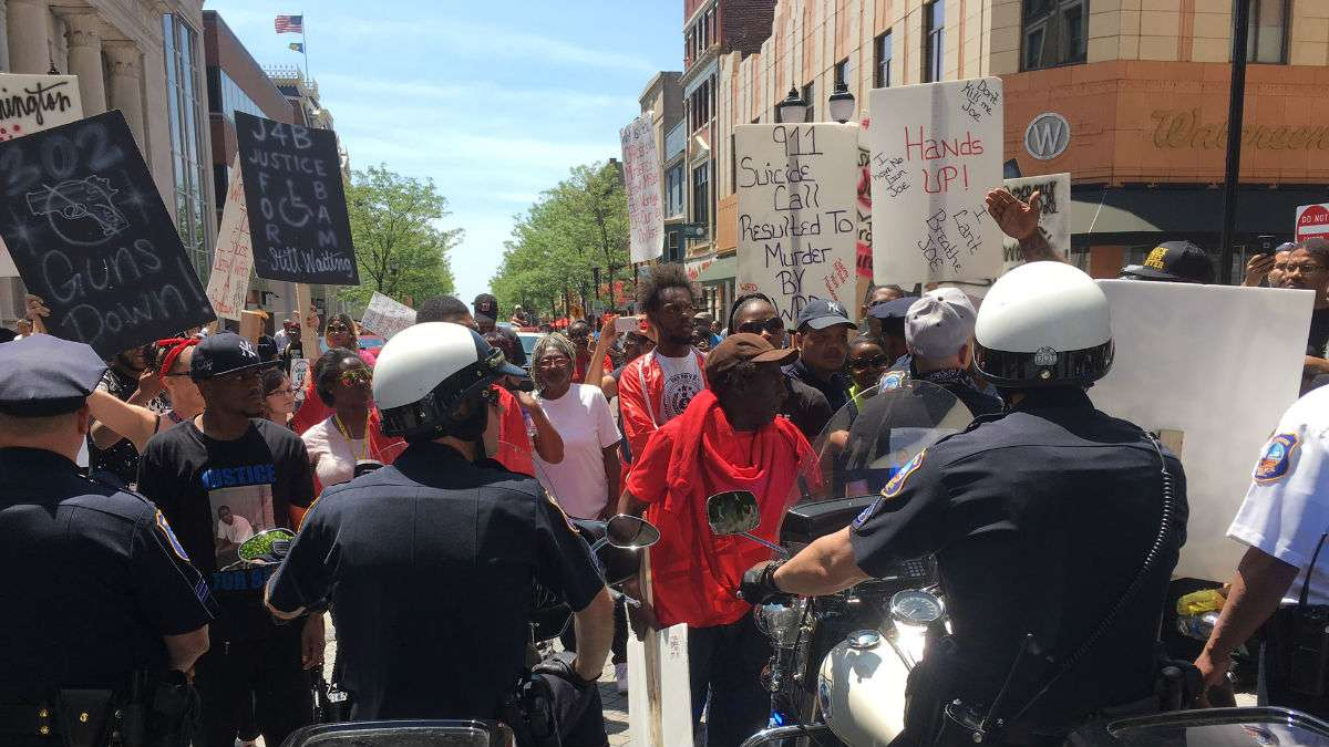 Protesters confront police on Market St. in downtown Wilmington after police shot Jeremy McDole to death in September, 2015. (John Jankowski for WHYY)