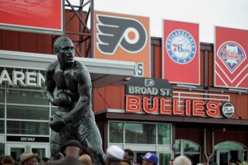 A behemoth bronze statue of Smokin' Joe Frazier, created by sculptor Stephen Layne, now stands on a pedestal on the former grounds of the Spectrum, which hosted many fights including several of Frazier's. (Bastiaan Slabbers/for NewsWorks)
