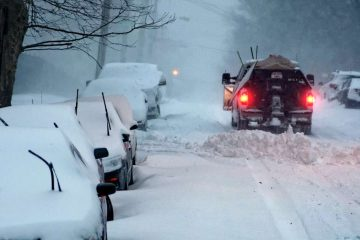 A snow plow is seen making its way up a steep section of Cresheim Road, Mt Airy, on Saturday morning